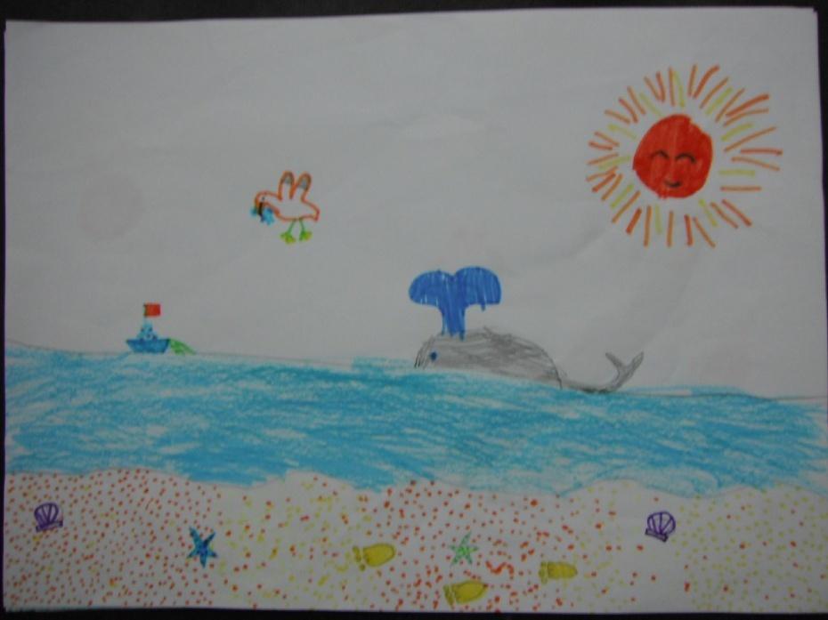 金色的沙滩,碧蓝的大海,沙滩上还有阿宝留下的小脚印.图片